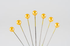 Yellow Sewing Pins Royalty Free Stock Photos