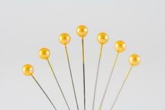 Yellow Sewing Pins Royalty Free Stock Photos