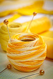 Yellow sewing thread. Yellow sewing and embroidery thread with pins Stock Photos