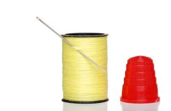 Yellow Sewing Thread With Needle And Thimble Stock Photos