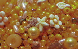 Yellow shaped beads. Background of yellow shaped beads Royalty Free Stock Photo