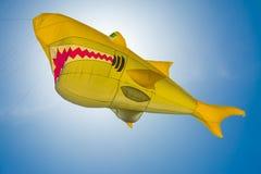 The yellow shark kite with backlight. VALENCIA, SPAIN. May 12, 2019: Kite International Festival. Malvarrosa beach. Contest with acrobatic and choreographic royalty free stock photos