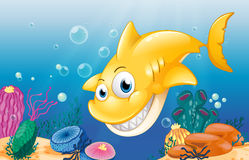 A yellow shark smiling under the sea. Illustration of a yellow shark smiling under the sea Royalty Free Stock Photo