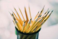 Yellow sharp pencil in black metal basket. Yellow sharp pencil in black metal basket Royalty Free Stock Photos