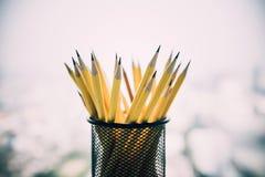 Yellow sharp pencil in black metal basket.. Yellow sharp pencil in black metal basket Stock Images