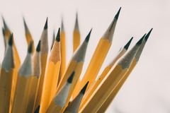 Yellow sharp pencil on white background. Yellow sharp pencil on white background Royalty Free Stock Photos