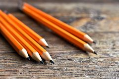Yellow Sharpened Pencils Close Up. A close up image of several wooden sharpened pencils on an old desk top Stock Photos