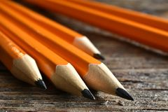 Yellow Sharpened Pencils Close Up. A close up image of several wooden sharpened pencils on an old desk top Royalty Free Stock Photos