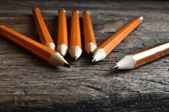 Yellow Sharpened Pencils Close Up. A close up image of several wooden sharpened pencils on an old desk top Stock Photography