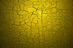 Yellow shatter color paint. On stone wall background Stock Images