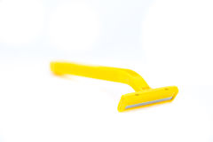Yellow shaver. Yellow new shaver with white background Stock Photo