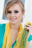Yellow shawl. Happy girl with yellow shawl stock images