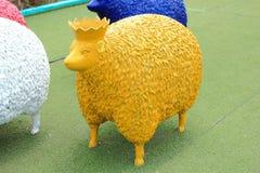 Yellow sheep statue Stock Photo