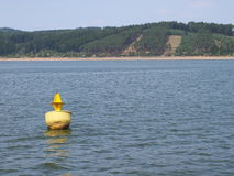 Yellow ship buoy floating. In a water royalty free stock photography