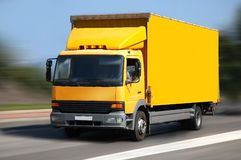 Yellow shipping. Yellow  shipping truck on road Stock Photos