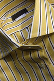 Yellow shirt. Photography of yellow shirt with white and brown stripes Stock Photography