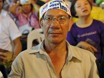 Yellow-Shirt Protester at a Rally in Bangkok Stock Photo