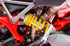 Yellow Shock Absorbers , a device for absorbing jolts. And vibrations of motocycle stock photo