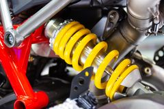 Yellow Shock Absorbers of Motorcycle for absorbing jolts. Concept new design technology royalty free stock image