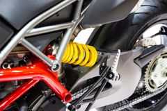 Yellow Shock Absorbers of Motorcycle for absorbing jolts. Net technology concept new technology design stock images