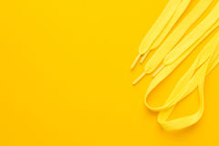 Yellow shoe laces. Sport shoe laces on the yellow background stock photography