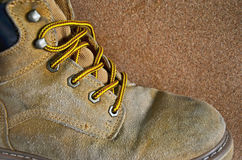Yellow and shoe strap of old leather footware Stock Photography