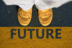 Yellow shoes on the asphalt, a step into the future. Royalty Free Stock Photo