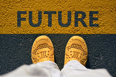 Yellow shoes on the asphalt, a step into the future. Stock Images