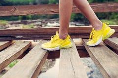Yellow shoes sport style walking on wooden bridge royalty free stock photo