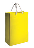 Yellow shopping bag Stock Photos