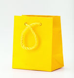 Yellow shopping bag. Stock Photo
