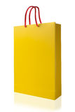 Yellow shopping bag, isolated with clipping path on white backgr Royalty Free Stock Images