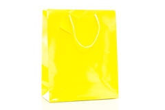 Yellow shopping bag on white background Royalty Free Stock Images