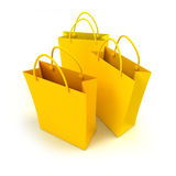 Yellow shopping bags trio Stock Image