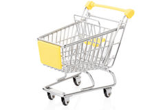 Yellow shopping cart on white Royalty Free Stock Photography