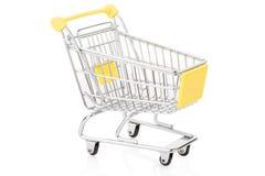 Yellow shopping cart on white Stock Photo