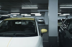 Yellow side mirror of car parked in garage. Royalty Free Stock Image