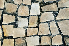 Yellow Sidewalk rocks background. Yellow Portuguese rocks of a sidewalk Royalty Free Stock Images