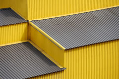 Yellow siding wall and roof Stock Photos