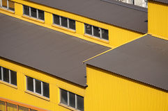 Yellow siding wall and roof Stock Photo