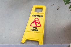 Yellow sign that alerts. For wet floor stock image