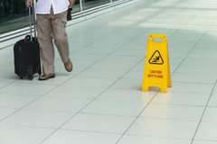 Yellow sign that alerts for wet floor. Royalty Free Stock Photography