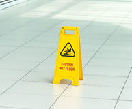 Yellow sign that alerts for wet floor. Stock Image