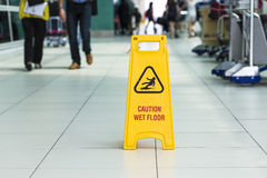 Yellow sign that alerts for wet floor. Royalty Free Stock Photo