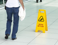 Yellow sign that alerts for wet floor. Royalty Free Stock Photos