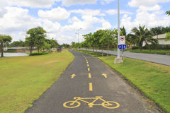 Yellow sign as bicycle lane in public park, Nakhonratchasima, Th Royalty Free Stock Image