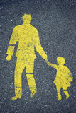 Yellow sign on the asphalt Royalty Free Stock Photo