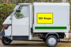 Yellow sign with 100% Biogas, German text for 100% Biogas, on a delivery van stock image