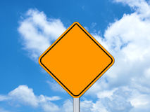 Yellow sign. On blue sky Stock Photography