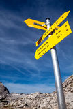 Yellow sign-board against mountain scenery Royalty Free Stock Image
